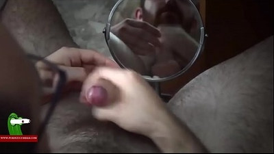 He enjoys a straw in front of a mirror watching porn movie