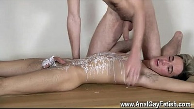 Gay porn Brit twink Oli Jay is roped down to the table, his smooth