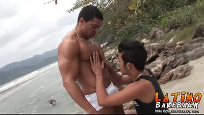 Two horny Brazilians enjoying fucking bareback on the beach