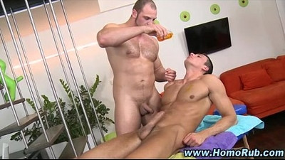 Straighty hunk rubbed down by masseur
